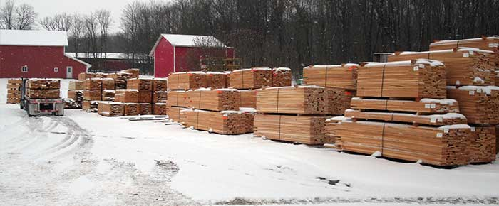 lumber being loaded onto semi trailer